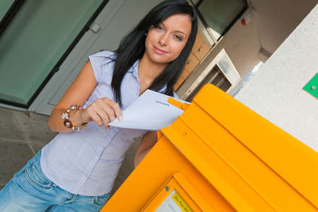 vote: young woman with a voting card  austria  Stock Photo