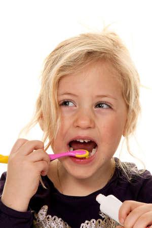 child brushing her teeth photo