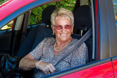 elderly woman with a seat belt in a car  photo