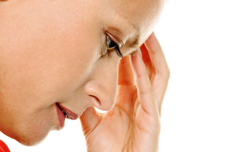 tenseness: a thoughtful young woman with headaches and migraines  Stock Photo