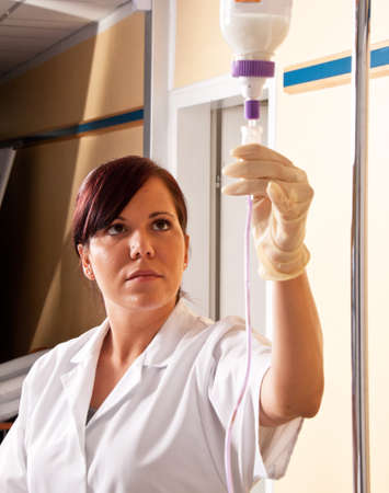 physican: a nurse gives a patient an infusion