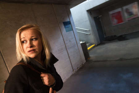 fear woman: a young woman in an underpass for pedestrians fear of harassment and crime