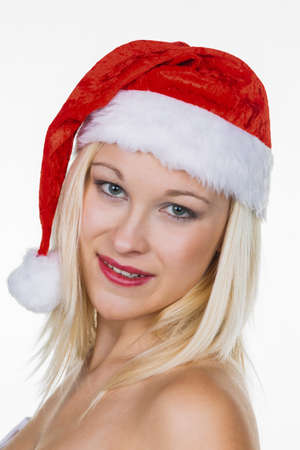 a young woman with the cap of a santa claus  christmas woman on christmas in front of white background Stock Photo - 16469395