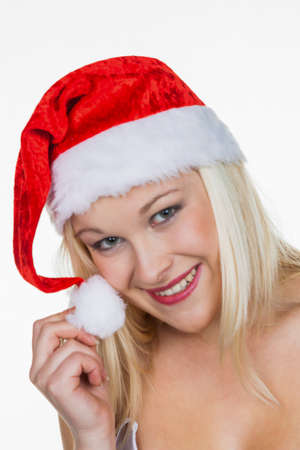 a young woman with the cap of a santa claus  christmas woman on christmas in front of white background Stock Photo - 16469361