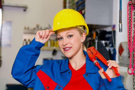 young mechanic with yellow helmet and wrench in a workshop  rare female occupations Stock Photo - 16469375