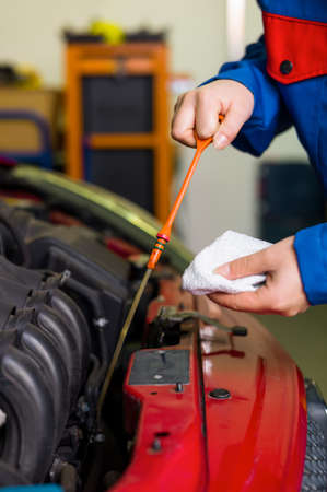 bonnet up: oil pressure is measured in the car  with the dipstick is the correct oil level checked Stock Photo