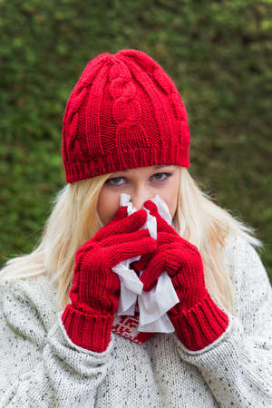 human immune system: a young woman has a cold and has a cold  autumn is the time for flu, colds and flu