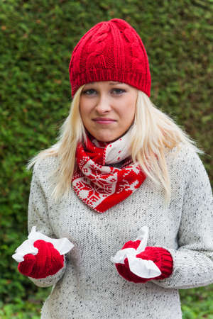 colds: a young woman has a cold and has a cold  autumn is the time for flu, colds and flu