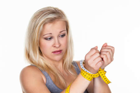 thinness: a young woman with a tape measure before the next diet  removing fast and Stock Photo