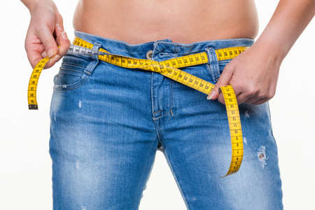 thinness: a young woman with a tape measure before the next diet  removing fast