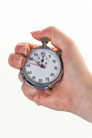 hectic: a hand with a stopwatch for timing  isolated white background Stock Photo