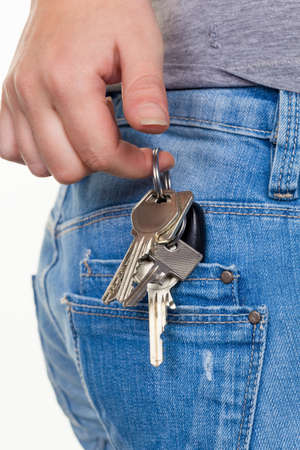 the hand of a young woman in jeans with keyring  key for car and home Stock Photo - 16453769