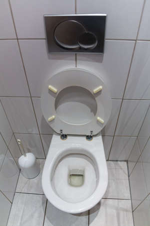 a toilet in an apartment  with an open toilet seat Stock Photo - 16678944