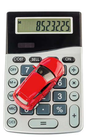 upkeep: a car sits on a pocket calculator  costs of fuel, insurance and wear  car costs are not paid by commuters