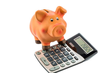 household money: a calculator beside a piggy bank  profitability when investing money  interest rates for savers