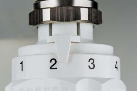 reduces: the thermostat of a radiator is slightly turned up  low room temperature reduces heating costs