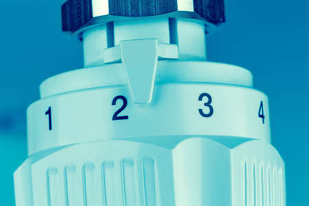 regulated: the thermostat of a radiator is slightly turned up  low room temperature reduces heating costs