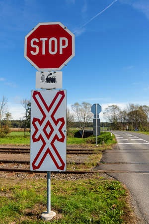 suffix: a crossing of a railway without barriers  secured only by traffic signs and whistles Stock Photo