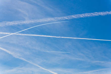 contrails of aircraft against a blue sky  routes in airways Stock Photo - 16678908