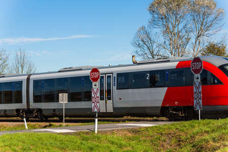 rail cross: a crossing of a railway without barriers  secured only by traffic signs and whistles Stock Photo