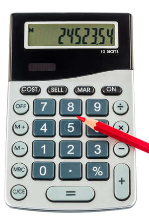 bad economy: a red pen on a calculator  save on costs, expenditures and budget for bad economy