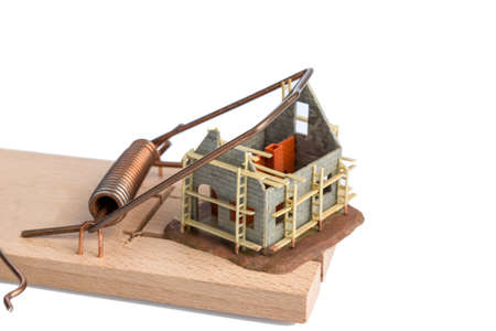 subsidy: model house of a shell in a mousetrap  symbolic photo for debt and housing crisis