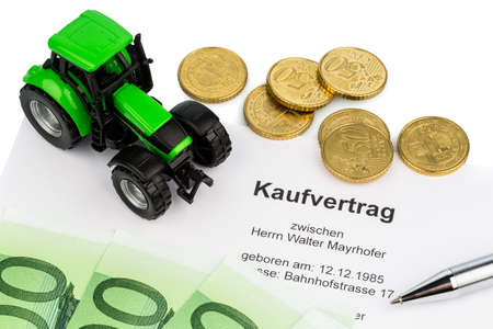the agreement to purchase a new tractor at a car dealership  with euro banknotes    Stock Photo - 17122327