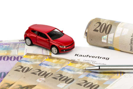 the agreement to purchase a new car at a swiss car dealer  with swiss francs Stock Photo - 17122213
