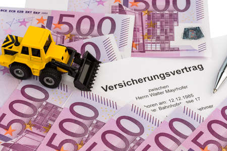 the insurance contract for a new excavator  with euro money and pen photo