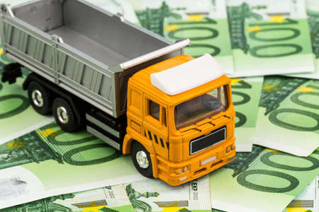 modernization: a truck and eurgeld banknotes  costs and revenues in the forwarding industry Stock Photo
