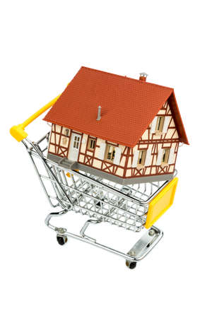 half-timbered house in the shopping cart icon photo for home purchase, financing, cost Stock Photo - 17122047