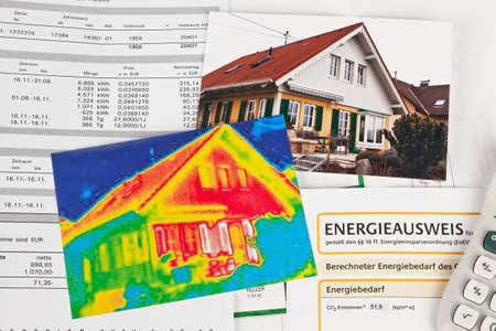 heat radiation: saving energy through insulation  house with thermal imaging camera photographed