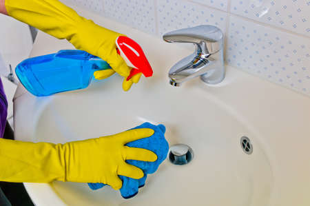 the sink of a bathroom is cleaned with latex gloves Stock Photo - 17122479