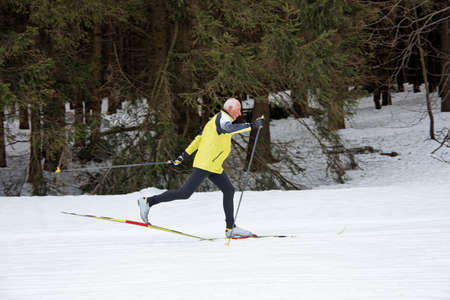 freetime activity: senior in winter on snow to cross country skiing with skis