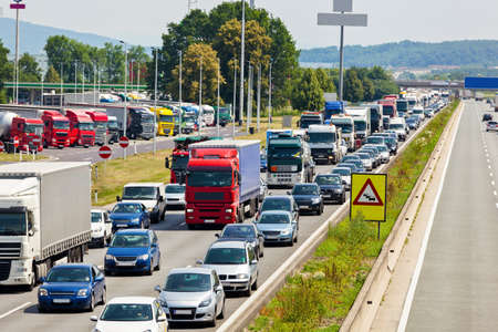 congestion: non-functioning emergency lane in a traffic jam on a highway