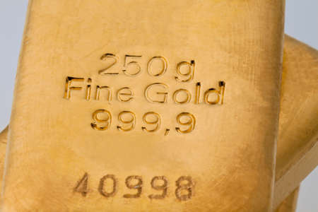 investment in real gold than gold bullion and gold coins photo