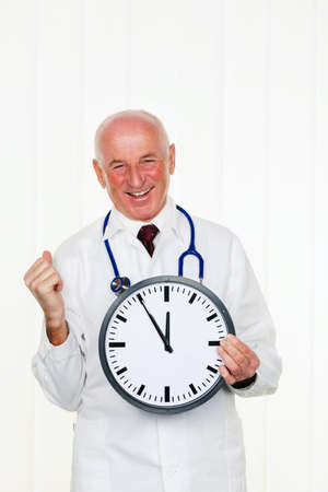 physican: a doctor holds a clock  on the ziffernbaltt is 11 55