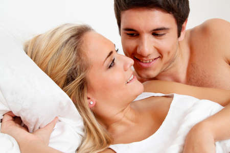 sex tenderness: couple has fun in bed  laughter, joy and eroticism in the bedroom