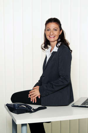 freelancers: successful young businesswoman at a desk Stock Photo