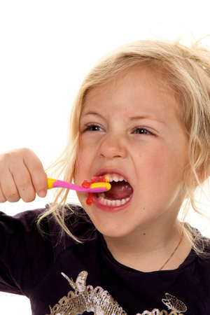 child while brushing your teeth  dental hygiene and cleaning