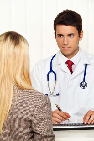 medical consultation  patient and doctor talking to a doctor s office Stock Photo - 17131039