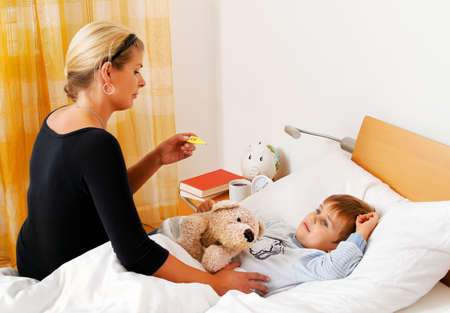 bedridden: a mother and sick child in bed  flu  childhood diseases