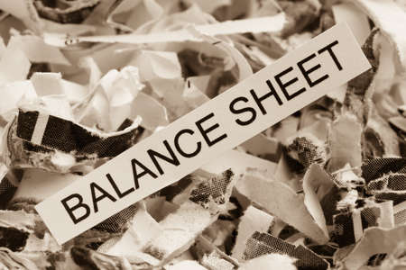 tagged: shredded paper tagged balance sheet, symbol photo for data destruction, budgets and accounting