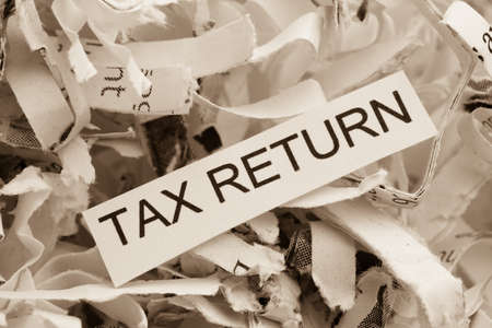 vat: of paper with the heading tax return, symbol photo for data destruction policy and tax law Stock Photo