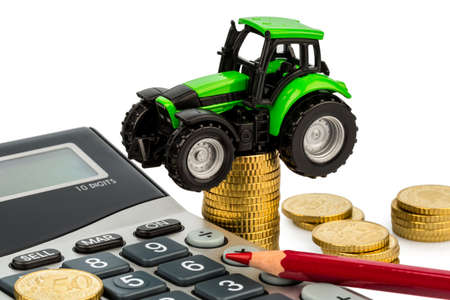 reckon: farmers in agriculture have to reckon with rising costs  higher prices for food, fertilizer and plants  tractor with coins and calculator