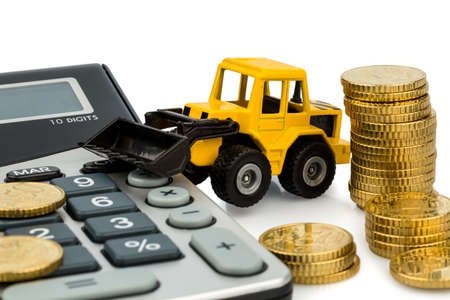 cost accounting in the construction industry and the construction industry  higher prices higher in road construction and in housing  excavators with coins and calculator Stock Photo - 17633894