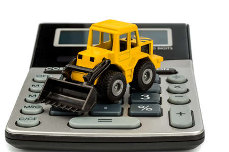 cost accounting in the construction industry and the construction industry  higher prices higher in road construction and in housing  excavators with coins and calculator Stock Photo - 17633768