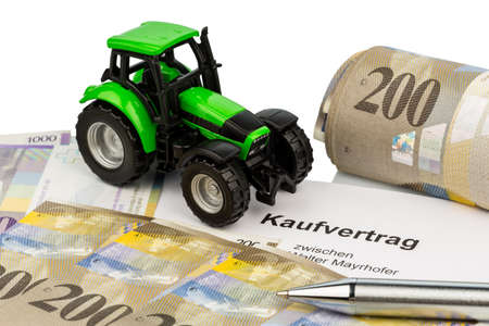 the agreement to purchase a new tractor with a swiss car dealer  with swiss francs  Stock Photo - 17634043