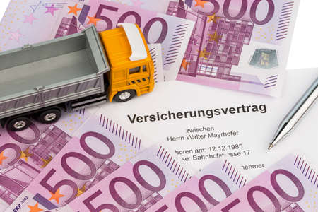 shipper: an insurance contract for new trucks  with euro money bills Stock Photo