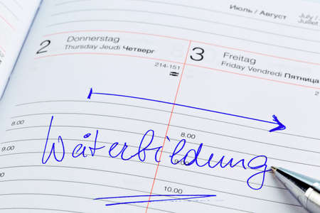 further education: a date is entered in a calendar  training Stock Photo